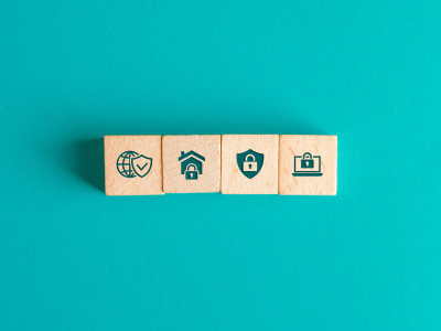 Security concept with icons on wooden blocks on turquoise background flat lay.